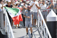 Max Sirena, center, skipper of Italy's Luna Rossa walks to his boat before leaving the dock to sail against Team New Zealand in race 7 of the America's Cup on Auckland's Waitemata Harbour, New Zealand, Sunday, March 14, 2021. (Alan Lee/Photosport via AP)