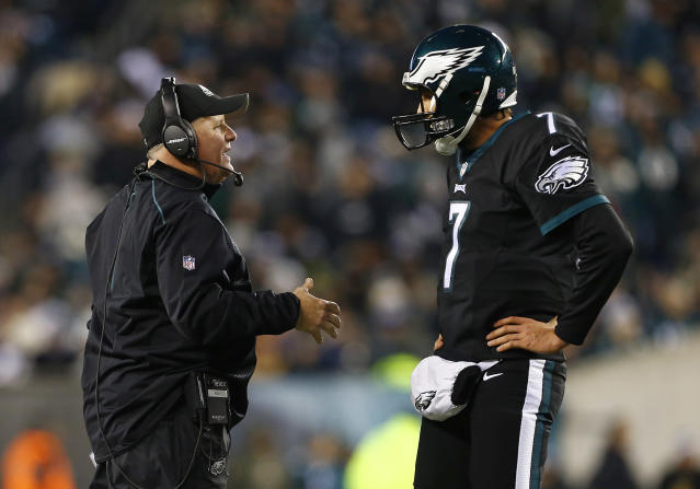 Chip Kelly, talking with quarterback Sam Bradford in 2015, finished 26-21 with the Eagles. (Getty Images)