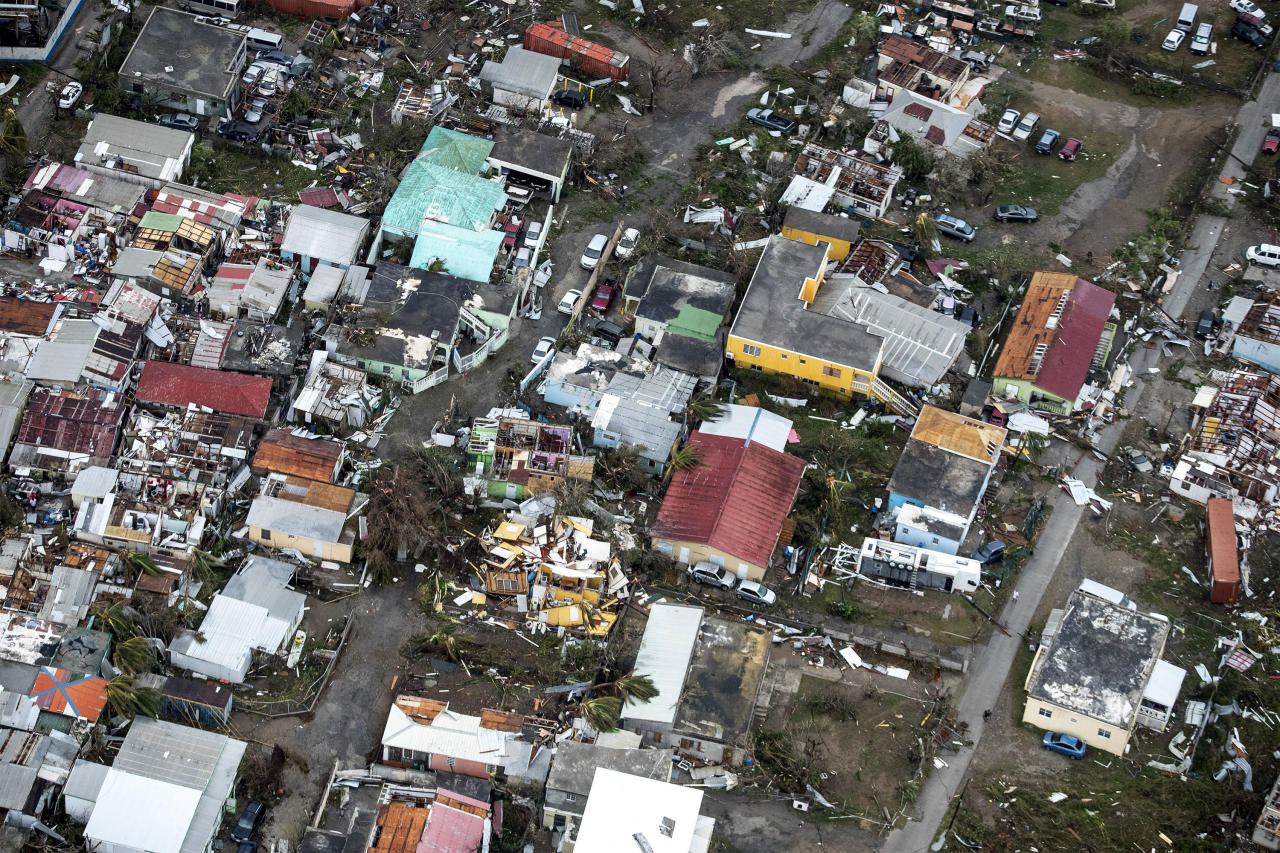 <p>Storm damage in the aftermath of Hurricane Irma, in St. Maarten. Irma cut a path of devastation across the northern Caribbean, leaving thousands homeless after destroying buildings and uprooting trees.(Photo: Gerben Van Es/Dutch Defense Ministry via AP) </p>