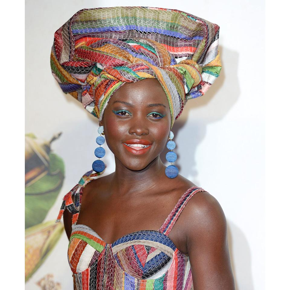 """<p>Many things made Lupita Nyong'o one glorious sight at a London screening of <em>Queen of Katwe,</em> but let's talk about her eyes: A crisp flick of iridescent emerald teams up with a sharp swipe of azure, creating a painterly palette of an outline. The smudge of pewter shadow up to the crease has a grounding effect.</p> <p><strong>More from Allure:</strong> <a rel=""""nofollow"""" href=""""http://www.allure.com/story/kim-kardashian-smiling?mbid=synd_yahoobeauty"""">Why Kim Kardashian Never Smiles in Photographs</a></p>"""