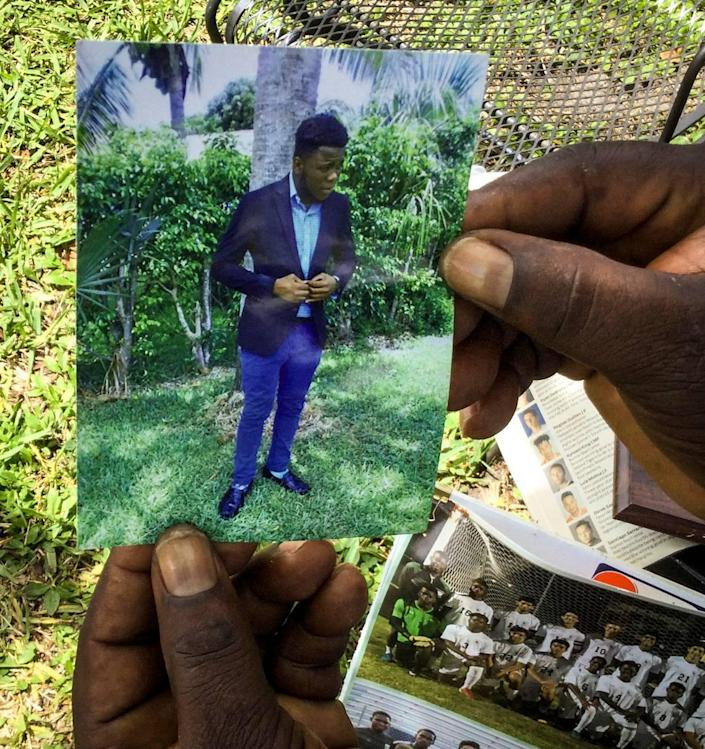 Calice Nalus, 57, of Delray Beach, shows a photo of son Lonelson, 25. He and two brothers left South Florida for an eight-day vacation in the Dominican Republic on July 29, 2020. Nearly a year later, they are still detained after being arrested on what the men say are false allegations of drug trafficking. Lonelson Nalus, a U.S. citizen born in Haiti, has pleaded to the U.S. government for help but so far gotten no response.