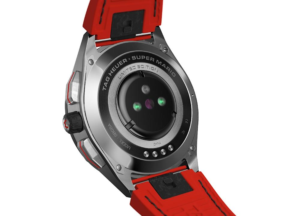 """<p>Back view of the Tag Heuer Connected Limited Edition Super Mario with a red strap. Above the heart rate sensor are the words """"Tag Heuer Super Mario LImited Edition.""""</p>"""