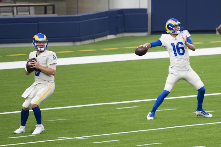 Rams quarterbacks John Wolford, left, and Jared Goff work on a drill Aug. 22, 2020.