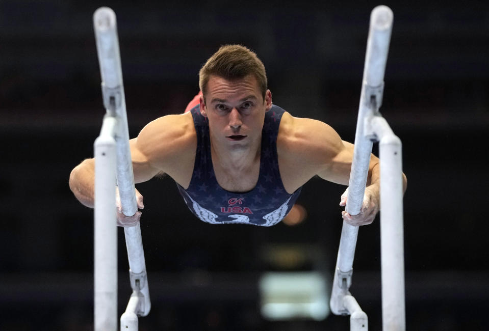 FILE - In this June 26, 2021, file photo, Sam Mikulak competes on the parallel bars during the men's U.S. Olympic Gymnastics Trials in St. Louis. On the eve of the Tokyo Games, it's clear that just arriving at this point for some of the world's greatest athletes was more of a mental-health challenge than it was a physical one. The COVID-19 postponement altered years of training plans, and the uncertain landscape amid the ongoing pandemic only added to lingering anxiety. (AP Photo/Jeff Roberson, File)