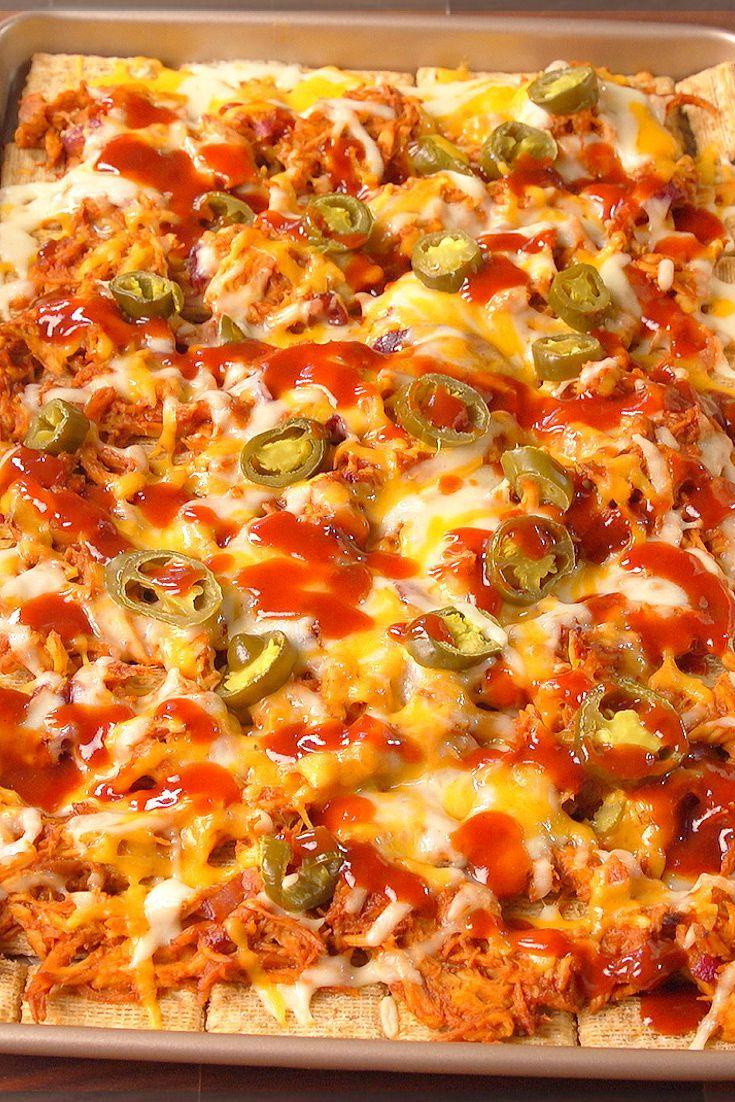 """<p>Forget the cheese plate and load up your favorite crackers with tasty toppings.</p><p>Get the recipe from <a href=""""https://www.delish.com/cooking/recipe-ideas/recipes/a49445/bbq-triscuit-nachos-recipe/"""" rel=""""nofollow noopener"""" target=""""_blank"""" data-ylk=""""slk:Delish"""" class=""""link rapid-noclick-resp"""">Delish</a>.</p>"""