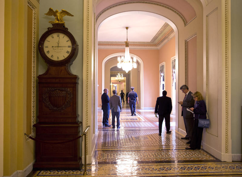 <p> The Ohio Clock shown outside the Senate Chamber on Capitol Hill on Thursday, Oct. 10, 2013 in Washington. The Ohio Clock has stood watch over the Senate for 196 years. It stopped running shortly after noon Wednesday. Employees in the Office of the Senate Curator ordinarily wind the clock weekly. But they are among the thousands of federal employees furloughed under the partial shutdown. (AP Photo/ Evan Vucci)