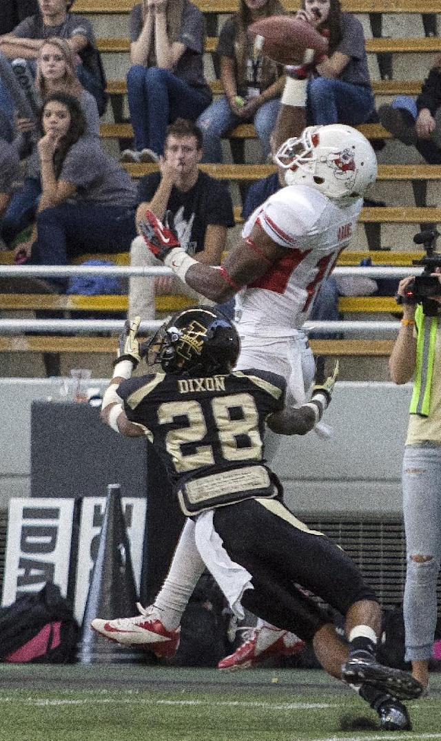 Fresno State wide receiver Davante Adams (15) makes a touchdown catch over Idaho's Solomon Dixon (28) during the first half of an NCAA college football game Saturday, Oct. 5, 2013, in Moscow, Idaho. (AP Photo/Dean Hare)
