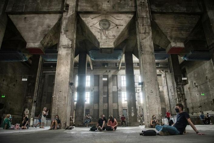 Visitors to the former power plant listen to the eery sound installation after Berlin's Berghain club re-opened its doors (AFP Photo/STEFANIE LOOS)