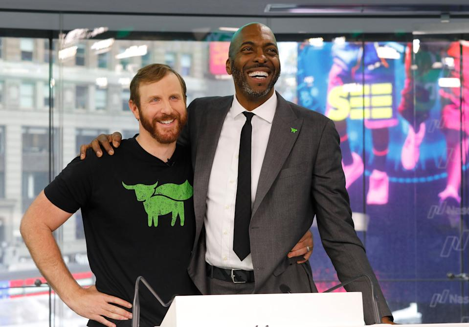 Ethan Brown, left, CEO of Beyond Meat, attends the Opening Bell ceremony with former NBA basketball player John Salley to celebrate the company's IPO at Nasdaq, Thursday, May 2, 2019 in New York. California-based Beyond Meat makes burgers and sausages out of pea protein and other ingredients. Salley is a professed vegan. (AP Photo/Mark Lennihan).