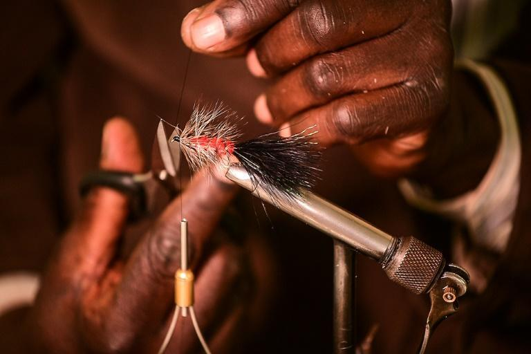 The artificial lures are designed to imitate the particular insects that trout, salmon and other species feast on (AFP/Simon MAINA)