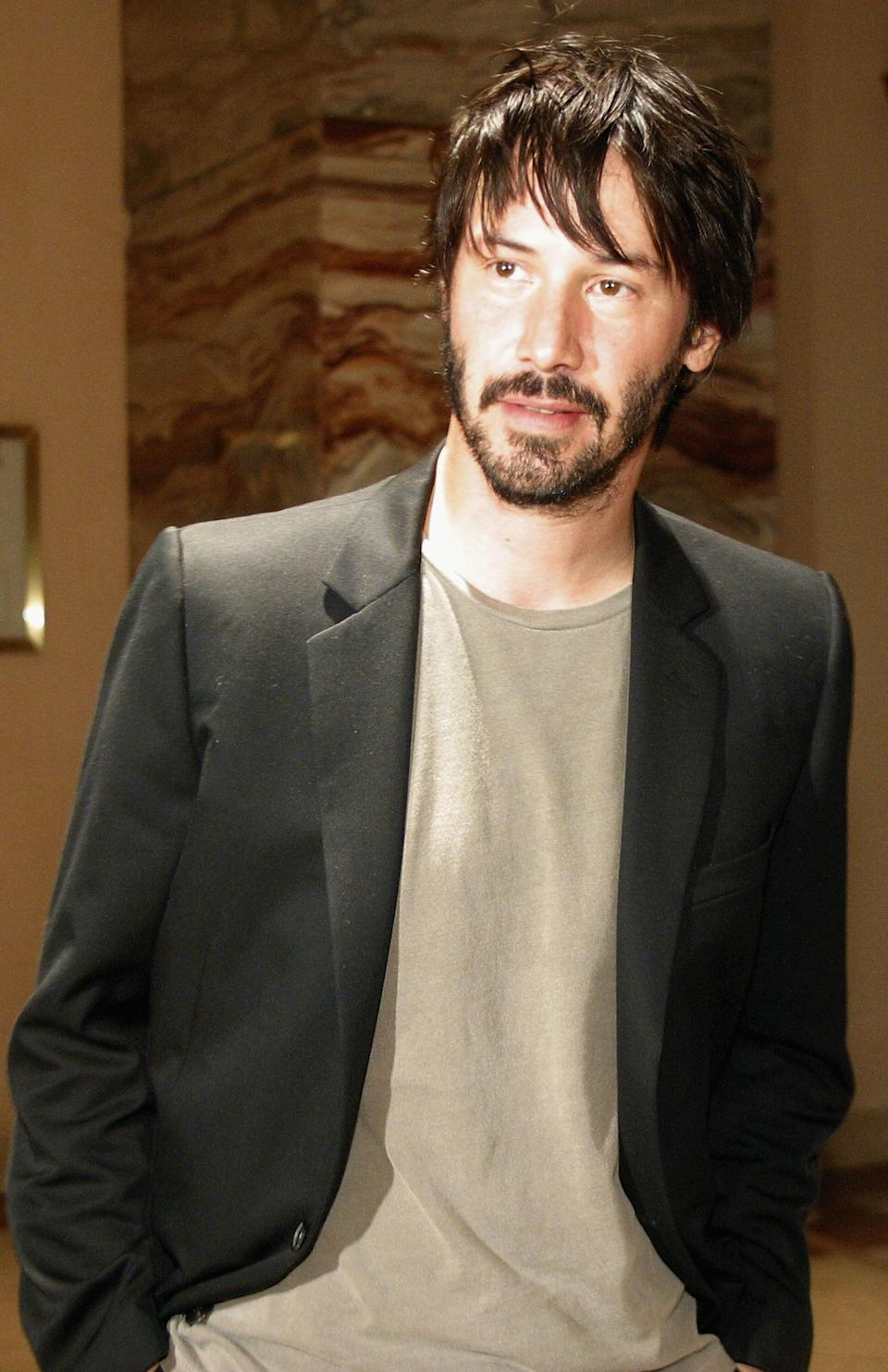 """Reeves meets his fans during the """"Lights, Camera, Fashion 2"""" show on June 4, 2004, in Austin, Texas."""