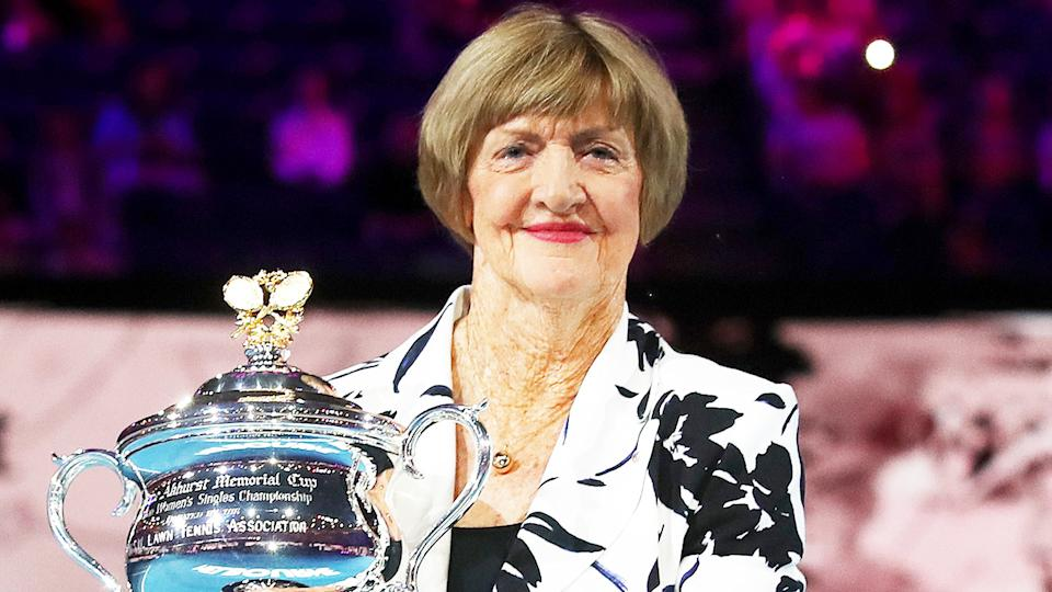 Margaret Court (pictured) holding up the Australian Open trophy.
