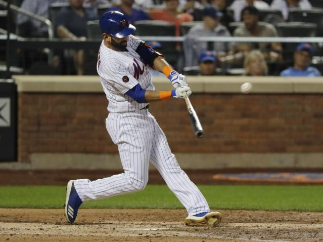 New York Mets' Jose Bautista hits a home run during the fourth inning of a baseball game against the San Francisco Giants on Wednesday, Aug. 22, 2018, in New York. (AP Photo/Frank Franklin II)