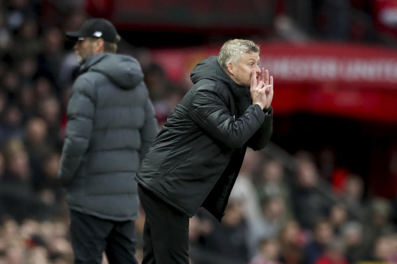 Manchester United's manager Ole Gunnar Solskjaer yells during the English Premier League soccer match between Manchester United and Liverpool at the Old Trafford stadium in Manchester, England, Sunday, Oct. 20, 2019. (AP Photo/Jon Super)