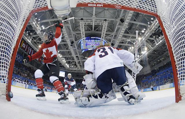 Meghan Agosta-Marciano of Canada celebrates her second goal of the game against USA Goalkeeper Jessie Vetter during the third period of the women's ice hockey game at the 2014 Winter Olympics, Wednesday, Feb. 12, 2014, in Sochi, Russia. Canada won 3-2 over the United States. (AP Photo/Matt Slocum, Pool)