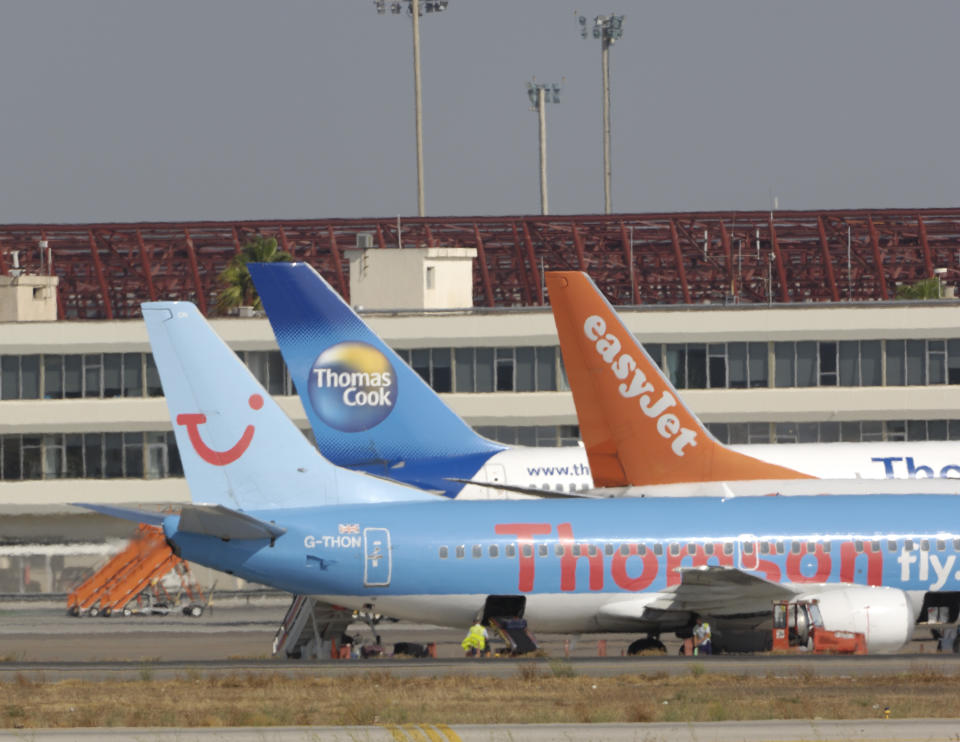 tail-fins of Thomsonfly.com Boeing 737-300, easyJet 737-800 and Thomas Cook 757-200 parked at the terminal at Palma International. (Photo by: aviation-images.com/Universal Images Group via Getty Images)