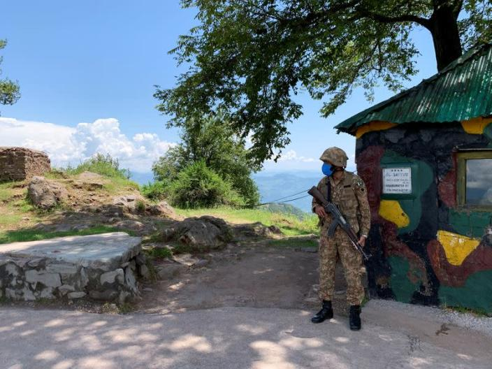 Pakistan Army soldier stands guard at a hilltop post during a trip organised by the army, near the Line of Control (LoC), in Charikot Sector, Kashmir