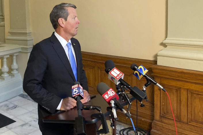 Georgia Gov. Brian Kemp speaks to reporters on Thursday, July 29, 2021, at the state capitol in Atlanta. The Republican governor says he encourages people to get vaccinated against COVID-19 but doesn't envision other measures unless hospitals get overwhelmed. (AP Photo/Jeff Amy)