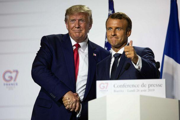 PHOTO: President Donald Trump and French President Emmanuel Macron join hands during the final press conference of the G7 Summit, Aug. 26, 2019, in Biarritz, France. (David Speier/NurPhoto via Getty Images)