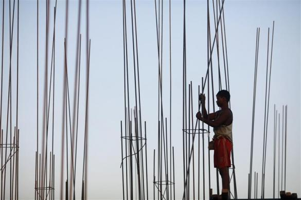 A laborer works in a construction site in Yangon, January 24, 2012.