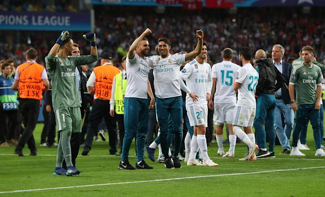 Soccer Football - Champions League Final - Real Madrid v Liverpool - NSC Olympic Stadium, Kiev, Ukraine - May 26, 2018 Real Madrid's Keylor Navas, Marco Asensio and team mates celebrate winning the Champions League at the end of the match REUTERS/Hannah McKay