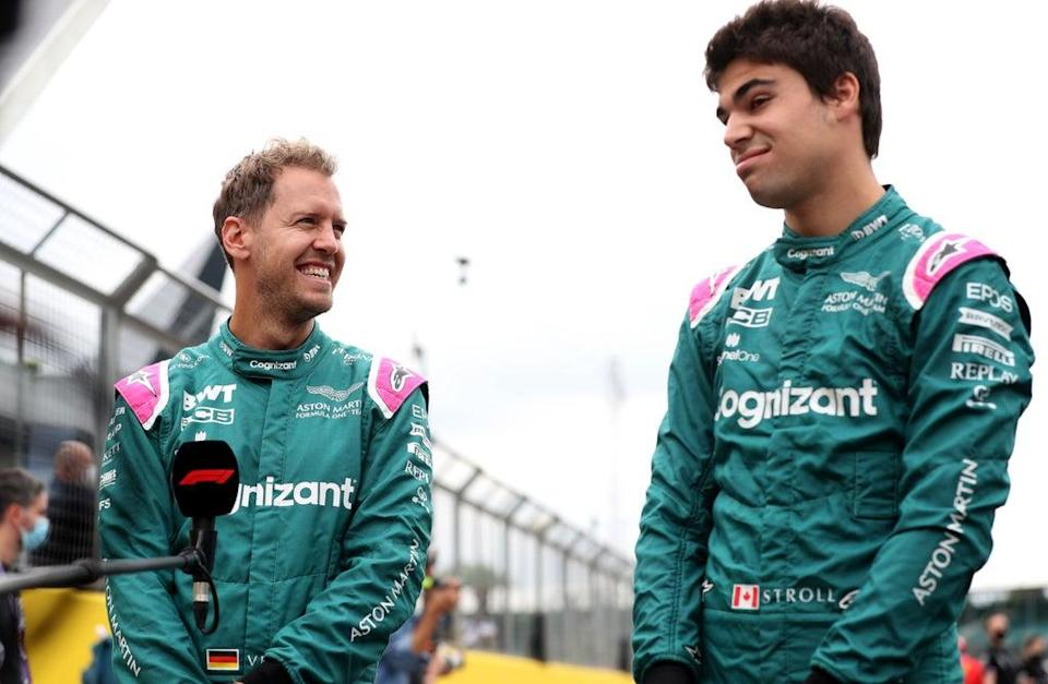 Aston Martin's Sebastian Vettel (left) and Lance Stroll will continue to race for the team in 2022 (Bradley Collyer/PA) (PA Wire)