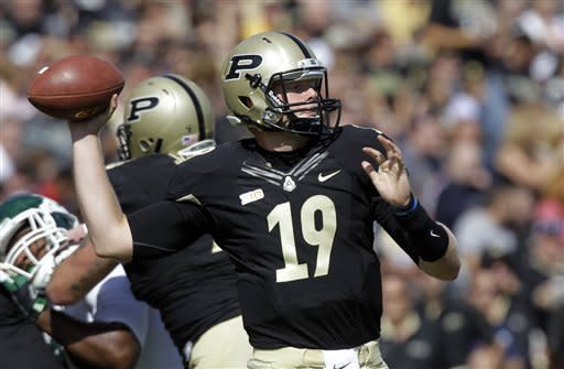Purdue quarterback Caleb TerBush throws against Eastern Michigan during the first half of an NCAA college football game in West Lafayette, Ind., Saturday, Sept. 15, 2012. (AP Photo/Michael Conroy)