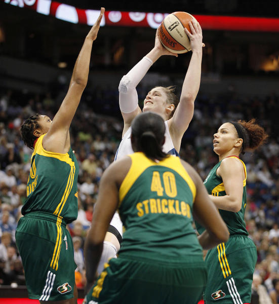 Minnesota Lynx guard Lindsay Whalen (13) takes a shot against Seattle Storm guard Tanisha Wright (30) in the opening game of a first-round WNBA basketball playoff series, Friday, Sept. 20, 2013, in Minneapolis. (AP Photo/Stacy Bengs)