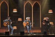"""Miranda Lambert, center, performs """"In His Arms"""" at the 56th annual Academy of Country Music Awards on Sunday, April 18, 2021, at the Ryman Auditorium in Nashville, Tenn. (Photo by Amy Harris/Invision/AP)"""