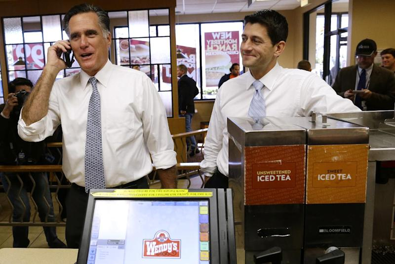 Republican presidential candidate, former Massachusetts Gov. Mitt Romney, left, talks on the phone with the store supervisor as he and his vice presidential running mate, Rep. Paul Ryan, R-Wis., make an unscheduled stop at a Wendy's restaurant in Richmond Heights, Ohio, on Election Day, Tuesday, Nov. 6, 2012. (AP Photo/Charles Dharapak)