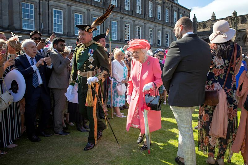 Britain's Queen Elizabeth II (C) attends a garden party at the Palace of Holyroodhouse in Edinburgh on July 3, 2019. (Photo by Jane Barlow / POOL / AFP) (Photo credit should read JANE BARLOW/AFP via Getty Images)