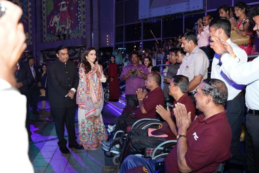 Nita and Mukesh Ambani are celebrating Akash and Shloka's wedding with not just family and friends but also with underprivileged children, residents of orphanages and old age homes, members and families of the forces, city workers and employees as part of the wedding celebrations and to seek their blessings. (Image: News18)