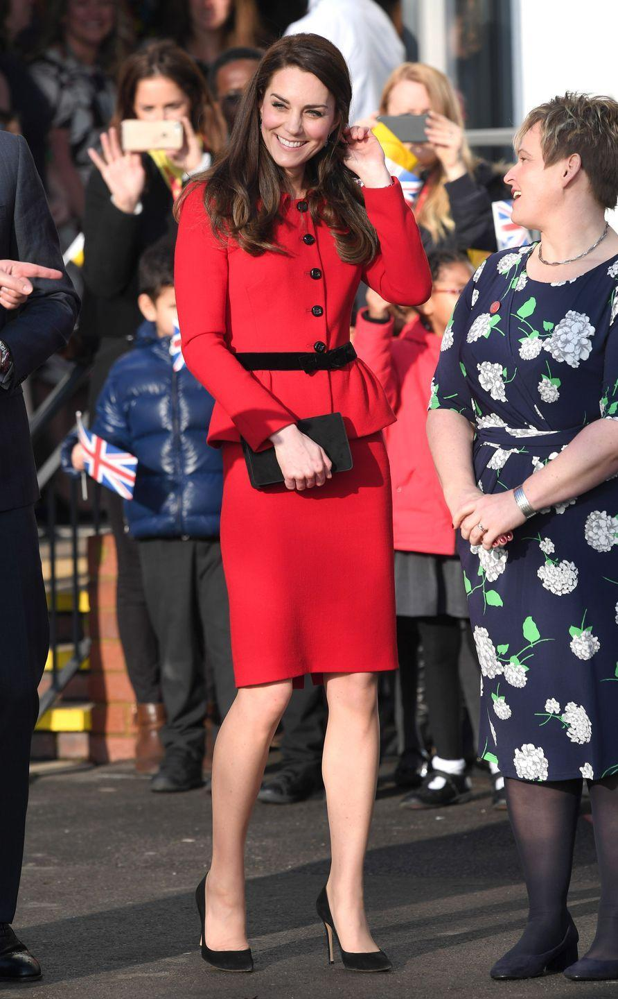 <p>The Duchess wears a bright red Luisa Spagnoli peplum skirt suit with black heeled pumps and a matching clutch a a Place2Be assembly in London. </p>