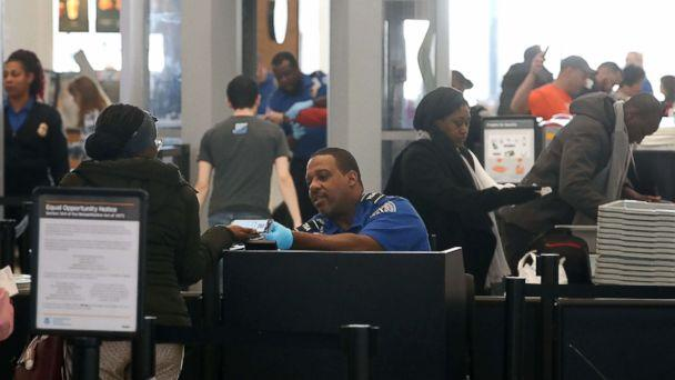 PHOTO: TSA employees, who are currently working without pay, screen passengers during the partial shutdown of the U.S. government, at Baltimore Washington International Thurgood Marshall Airport, on Jan. 14, 2019 in Baltimore. (Mark Wilson/Getty Images)