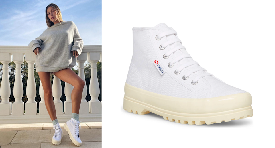 Hailey Bieber wearing her Superga 2341 Alpina High Top sneakers on balcony with grey sweater and bare legs