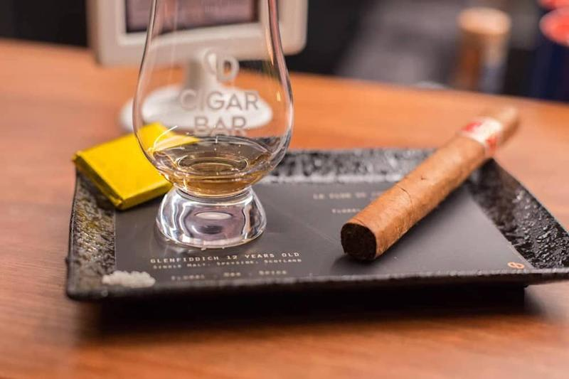 Each curated pairing option comes with a cigar, 30ml dram of whisky or rum, dark chocolate and French sea salt. — Picture courtesy of Cigar Bar