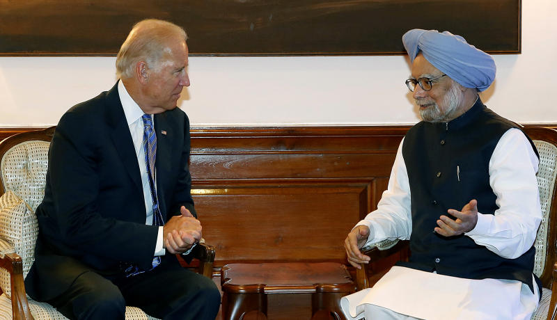 Indian Prime Minister Manmohan Singh, right, gestures while speaking with U.S. Vice President Joe Biden during a meeting in New Delhi, India, Tuesday, July 23, 2013. Biden arrived in India on Monday on a trip that will focus on boosting trade and regional security ties and strengthening a strategic partnership that has languished in recent years. (AP Photo/Pool, Harish Tyagi)