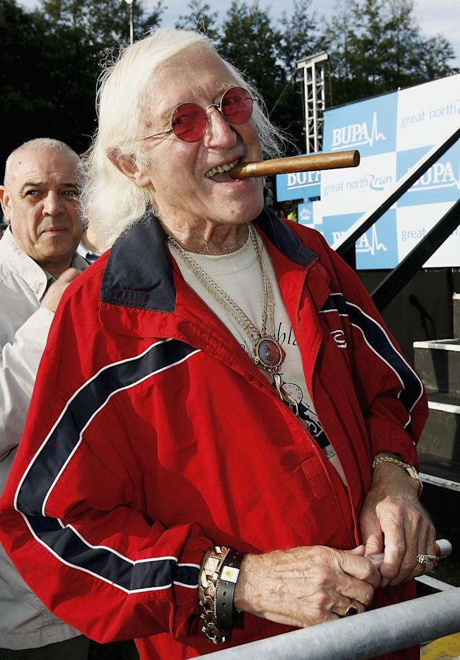 NEWCASTLE, ENGLAND - OCTOBER 1:  (FILE PHOTO) Jimmy Savile, 84, has reportedly died on October 29, 2011. Please refer to the following profile on Getty Images Archival for further imagery.  http://www.gettyimages.co.uk/Search/Search.aspx?EventId=131000729&EditorialProduct=News  Sir Jimmy Saville prepares for The Bupa Great North Run on October 1, 2006 in Newcastle, England.   (Photo by Matthew Lewis/Getty Images)