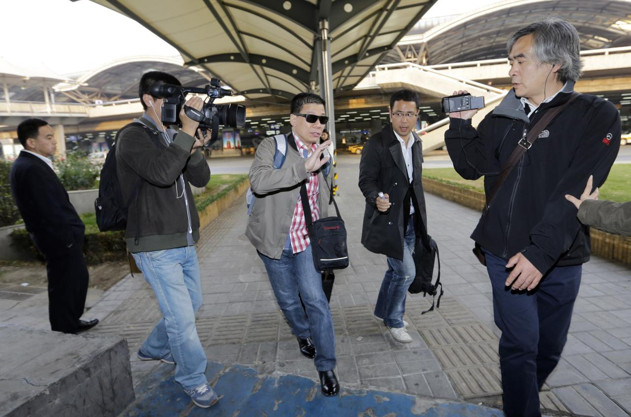 A relative of Filipino Rizalina Bunyi, who died in the car incident which killed five pedestrians in front of Tiananmen Gate on Monday, is pictured as he and other relatives arrive at Beijing airport, October 30, 2013. Chinese authorities investigating what could be Beijing's first major suicide attack searched on Tuesday for two men from Muslim-dominated Xinjiang after three people suspected to be from the restive region drove an SUV into a crowd at Tiananmen Square and set it on fire. Police are still investigating and have yet to determine the identities of the three people in the sport utility vehicle but suspect they are from Xinjiang, according to the sources. The other dead were a Chinese man and a woman from the Philippines, both tourists. REUTERS/Jason Lee (CHINA - Tags: POLITICS CRIME LAW)