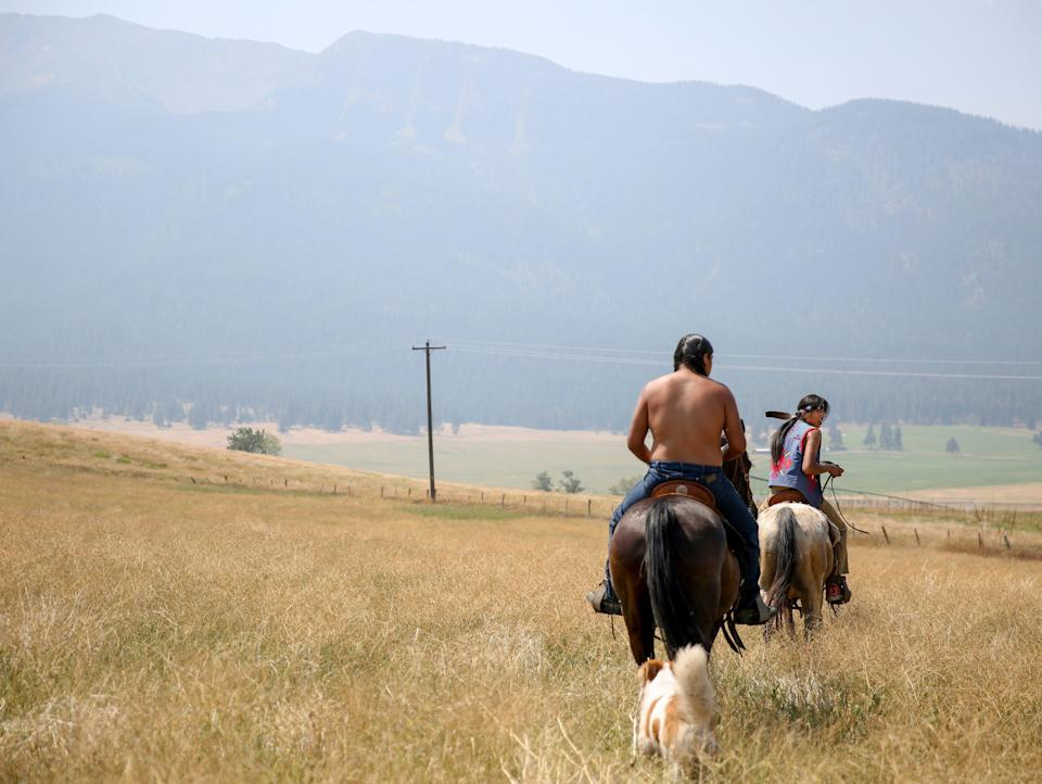 """Leland Whiteplume and Farley Eagle Speaker ride horses on Am'sáaxpa or """"the place of boulders,"""" on Thursday, July 29, 2021 in Joseph, Ore."""