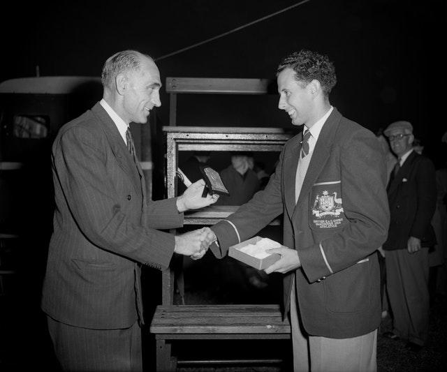 John Landy, right, threatened to become the first man to break the four-minute mile barrier on several occasions