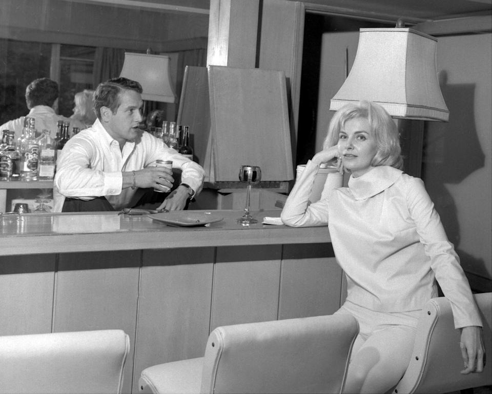 <p>Paul Newman and Joanne Woodward tuck in for a drink at the mid-century modern bar inside their Los Angeles home in 1962. Now the real question is what is Cool Hand Luke's beverage of choice?</p>