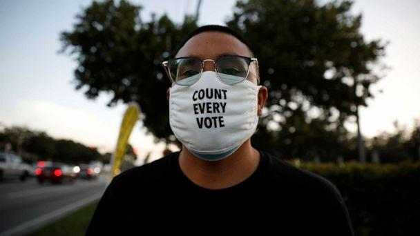 PHOTO: A voter wears a 'Count Every Vote' face mask outside the Miami-Dade County Elections Department during the presidential election in Miami, Nov. 3, 2020. (Marco Bello/Reuters)