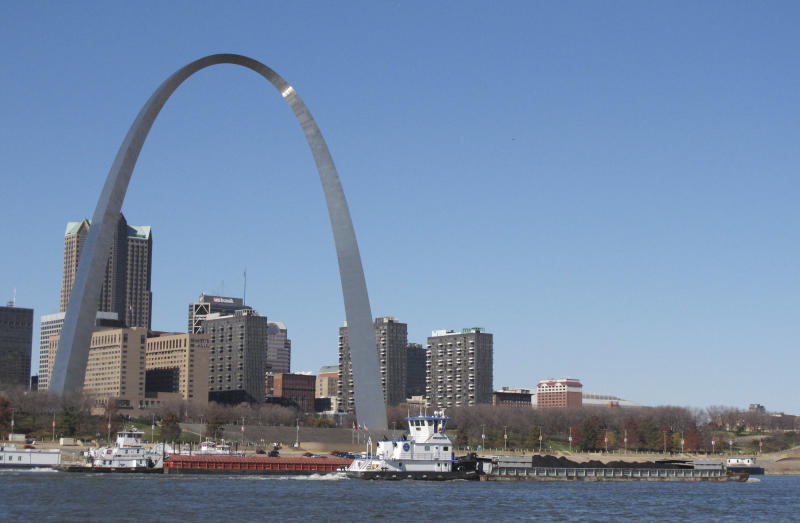 """Two barges head north on the Mississippi River past St. Louis on Monday, Nov. 12, 2012, as seen from East St. Louis, Ill. Missouri Gov. Jay Nixon and the barge industry are pressing the federal government to take steps to keep enough water flowing on the drought-ridden Missouri and Mississippi rivers to avert a potential """"economic disaster,"""" given the Mississippi's importance as a commerce corridor. Winter typically is a low-water period on the two big rivers, but the situation is more dire this year with many points long the waterways at or near historic lows. (AP Photo/Jim Suhr)"""