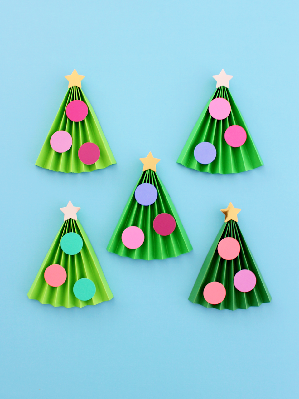 """<p>All kids need is five minutes to make this super-simple Christmas tree craft. Fold green craft paper accordion style, and then deck it with colorful paper cutouts as ornaments — and don't forget the star on top.</p><p><em><a href=""""https://www.whitehousecrafts.net/post/2019/11/24/5-minute-kids-accordion-christmas-tree-craft"""" rel=""""nofollow noopener"""" target=""""_blank"""" data-ylk=""""slk:Get the tutorial at White House Crafts"""" class=""""link rapid-noclick-resp"""">Get the tutorial at White House Crafts </a></em></p>"""