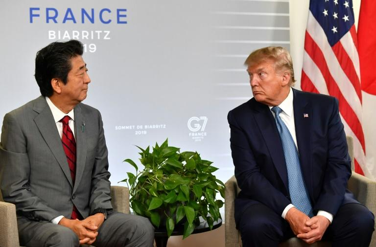Japan's Prime Minister Shinzo Abe (L) and US President Donald Trump , pictured on the sidelines of the G7 summit in Biarritz in August, are set to sign a trade deal on the sidelines of the UN General Assembly meeting in New York (AFP Photo/Nicholas Kamm)