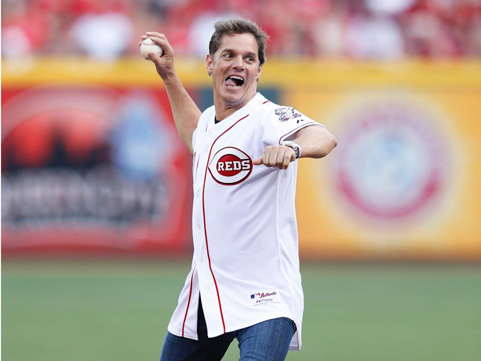 Fox News Channel television news anchor Bill Hemmer throws out the first pitch before the game between the Pittsburgh Pirates and Cincinnati Reds at Great American Ball Park on July 12, 2014 in Cincinnati, Ohio.