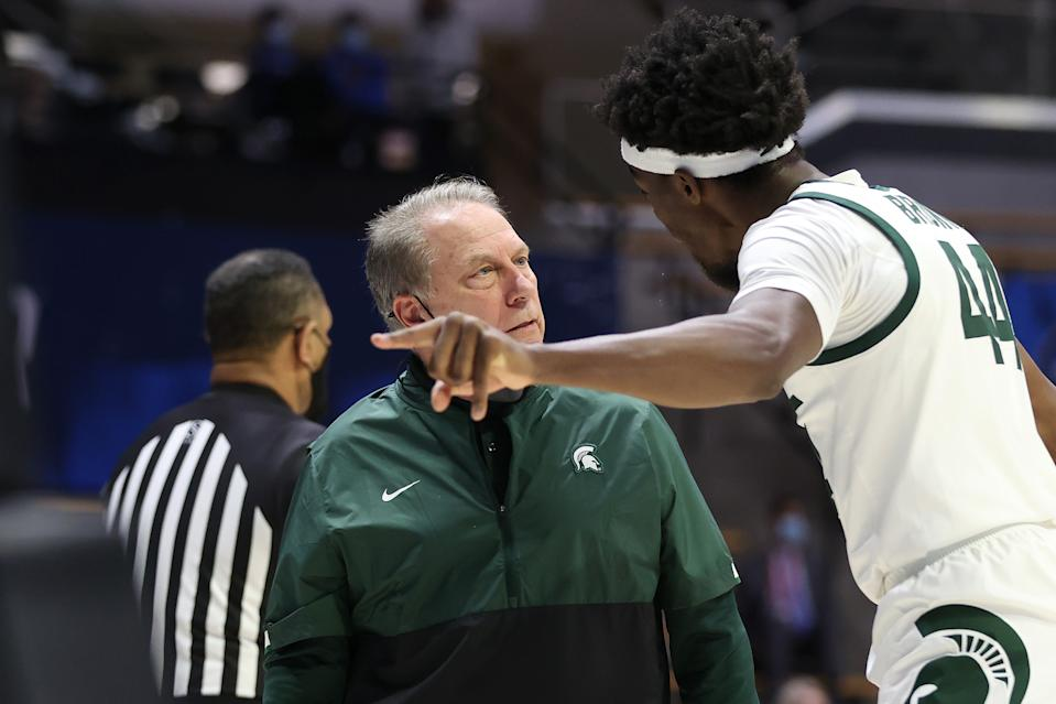 WEST LAFAYETTE, INDIANA - MARCH 18: Head coach Tom Izzo of the Michigan State Spartans talks with Gabe Brown #44 of the Michigan State Spartans against the UCLA Bruins during the first half in the First Four game prior to the NCAA Men's Basketball Tournament at Mackey Arena on March 18, 2021 in West Lafayette, Indiana. (Photo by Gregory Shamus/Getty Images)