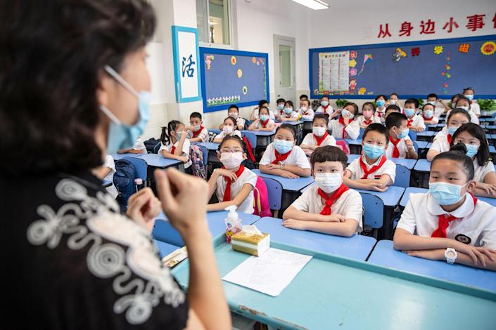 Image: Elementary school students attending a class on the first day of the new semester in Wuhan in China's central Hubei province. (AFP via Getty Images file)