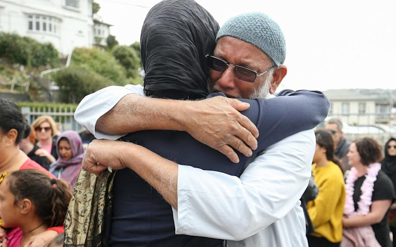 Prime Minister Jacinda Ardern hugs a mosque-goer at the Kilbirnie Mosque - Getty Images AsiaPac